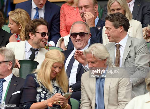 Bradley Cooper FrancoisHenri Pinault and Hugh Grant attend day 13 of the Wimbledon Tennis Championships at Wimbledon on July 12 2015 in London England