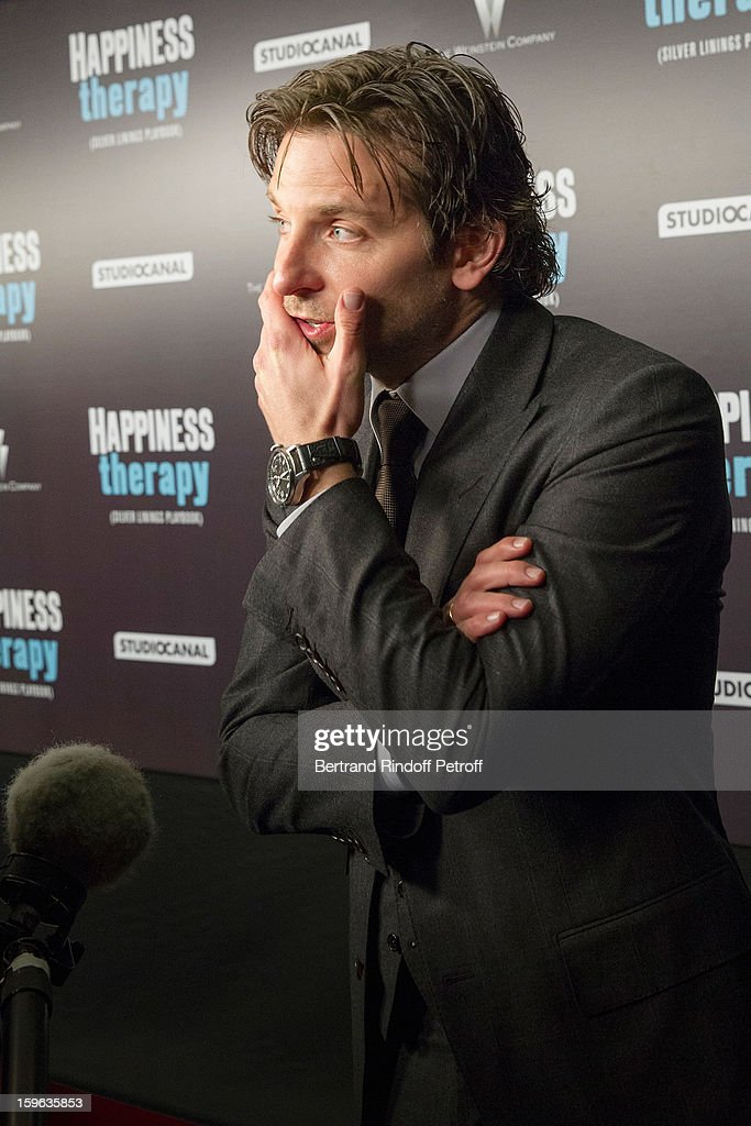 <a gi-track='captionPersonalityLinkClicked' href=/galleries/search?phrase=Bradley+Cooper&family=editorial&specificpeople=680224 ng-click='$event.stopPropagation()'>Bradley Cooper</a> is being interviewed as he attends the premiere of 'Happiness Therapy' (Silver Linings Playbook) at Cinema UGC Normandie on January 17, 2013 in Paris, France.