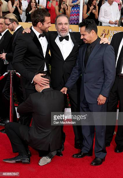 Bradley Cooper Michael Pena and Vitalii Sediuk arrive at the 20th Annual Screen Actors Guild Awards at the Shrine Auditorium on January 18 2014 in...