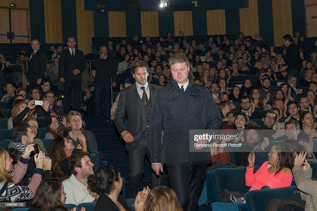 Bradley Cooper (Rear C) walks towards the stage to deliver a presentation speech before the screening of 'Happiness Therapy' (Silver Linings Playbook) during its premiere at Cinema UGC Normandie on January 17, 2013 in Paris, France.