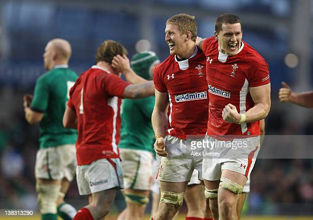 Bradley Davies and Ian Evans of Wales celebrate at the final whistle after victory over Ireland in the RBS Six Nations match between Ireland and...