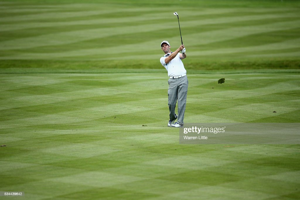 <a gi-track='captionPersonalityLinkClicked' href=/galleries/search?phrase=Bradley+Dredge&family=editorial&specificpeople=204308 ng-click='$event.stopPropagation()'>Bradley Dredge</a> of Wales hits his 2nd shot on the 18th hole during day one of the BMW PGA Championship at Wentworth on May 26, 2016 in Virginia Water, England.