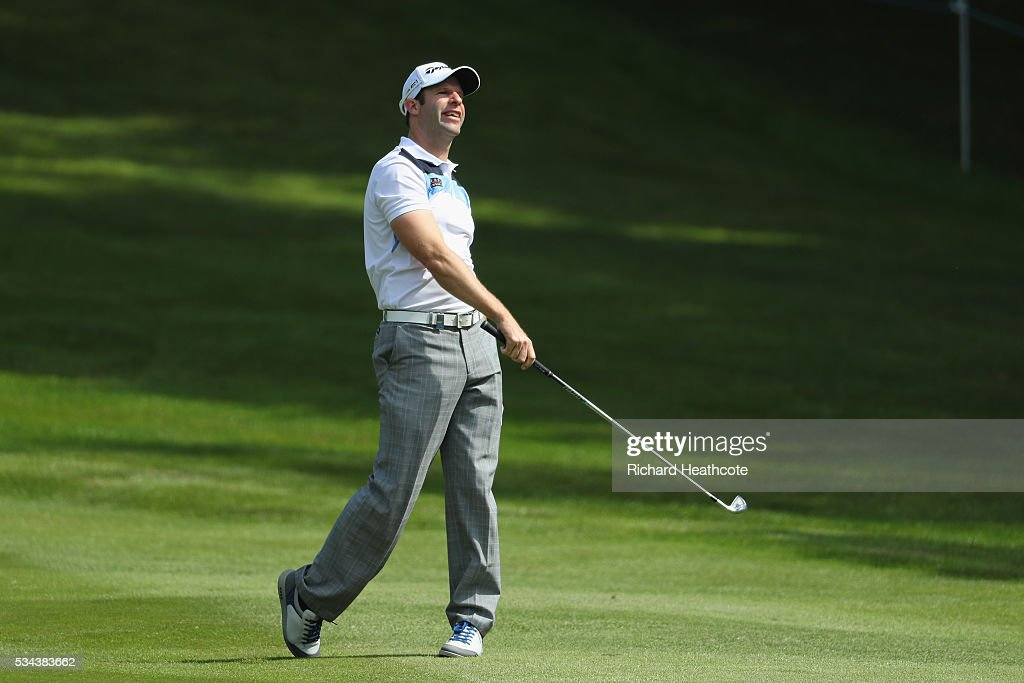 <a gi-track='captionPersonalityLinkClicked' href=/galleries/search?phrase=Bradley+Dredge&family=editorial&specificpeople=204308 ng-click='$event.stopPropagation()'>Bradley Dredge</a> of Wales hits his 2nd shot on the 4th hole during day one of the BMW PGA Championship at Wentworth on May 26, 2016 in Virginia Water, England.