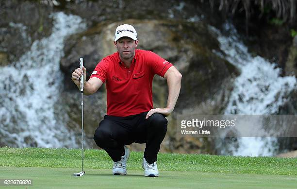 Bradley Dredge of Wales lines up a putt on the ninth green during the third round of the Nedbank Golf Challenge at the Gary Player CC on November 12...