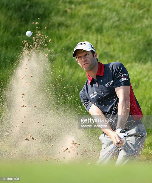 Bradley Dredge of Wales plays a bunker shot on the 17th hole during the first round of the Celtic Manor Wales Open on The Twenty Ten Course at The...