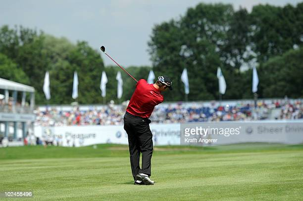 Bradley Dredge of Wales plays his second shot on the 18th hole during the final round of the BMW International Open at the Munich North Eichenried...