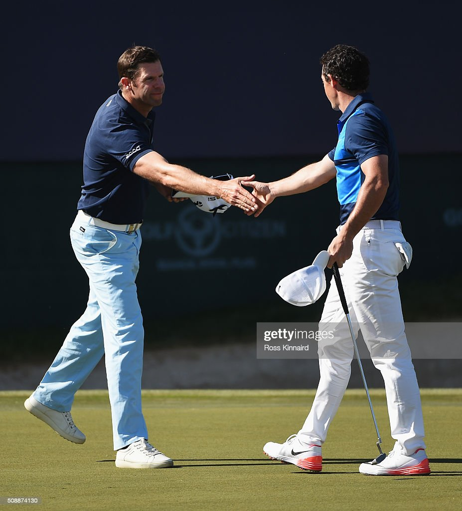<a gi-track='captionPersonalityLinkClicked' href=/galleries/search?phrase=Bradley+Dredge&family=editorial&specificpeople=204308 ng-click='$event.stopPropagation()'>Bradley Dredge</a> (L) of Wales shakes hands with <a gi-track='captionPersonalityLinkClicked' href=/galleries/search?phrase=Rory+McIlroy&family=editorial&specificpeople=783109 ng-click='$event.stopPropagation()'>Rory McIlroy</a> of Northern Ireland on the 18th green during the final round of the Omega Dubai Desert Classic at the Emirates Golf Club on February 7, 2016 in Dubai, United Arab Emirates.