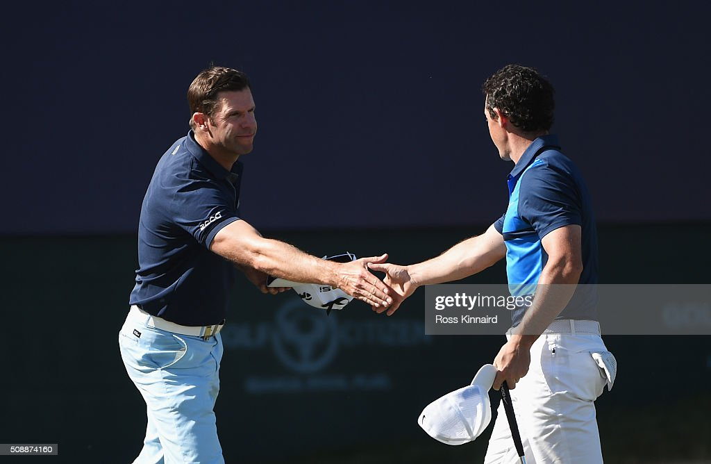 <a gi-track='captionPersonalityLinkClicked' href=/galleries/search?phrase=Bradley+Dredge&family=editorial&specificpeople=204308 ng-click='$event.stopPropagation()'>Bradley Dredge</a> (L) of Wales shakes hands with Rory McIlroy of Northern Ireland on the 18th green during the final round of the Omega Dubai Desert Classic at the Emirates Golf Club on February 7, 2016 in Dubai, United Arab Emirates.