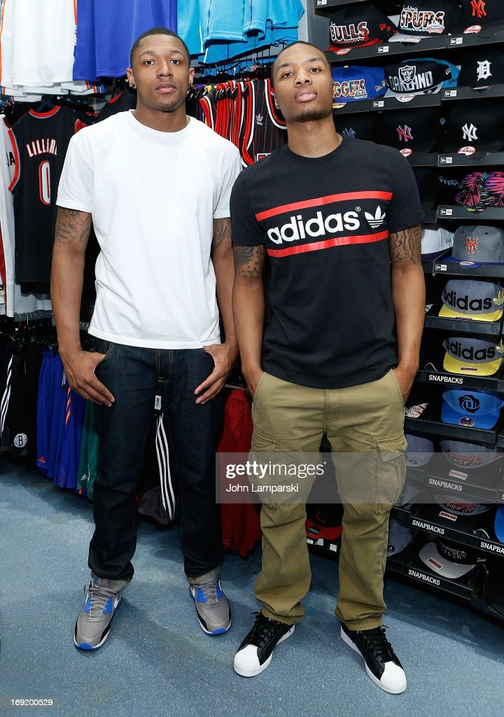 Bradley Emmanuel Beal (L) of the Washington Wizards and <a gi-track='captionPersonalityLinkClicked' href=/galleries/search?phrase=Damian+Lillard&family=editorial&specificpeople=6598327 ng-click='$event.stopPropagation()'>Damian Lillard</a> of the Portland Trail Blazers attend a meet and greet at Champs Sports on May 21, 2013 in New York City.