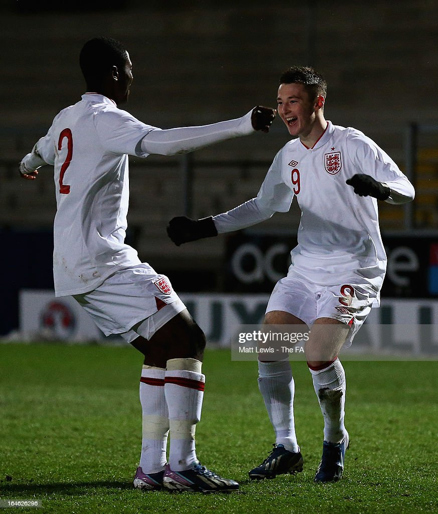 Bradley Fewster of England celebrates his goal with Temitayo Aina during the UEFA European Under-17 Championship Elite Round match between England and Russia at Pirelli Stadium on March 25, 2013 in Burton-upon-Trent, England.