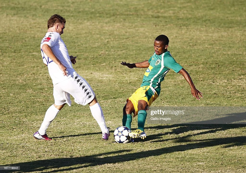 Bradley Grobler ( l) challenges Sibusiso Hadebe during the Absa Premiership match between Golden Arrows and SuperSport United at Princess Magogo Stadium on April 28, 2013 in Durban, South Africa.