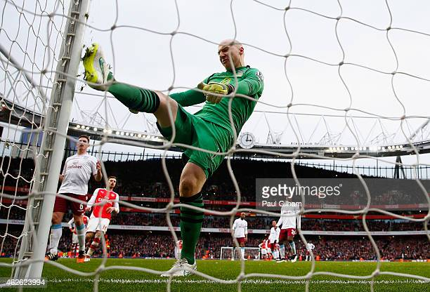 Bradley Guzan of Aston Villa kicks the post in frustration after conceding a penalty and Arsenal's fourth goal to Santi Cazorla of Arsenal during the...