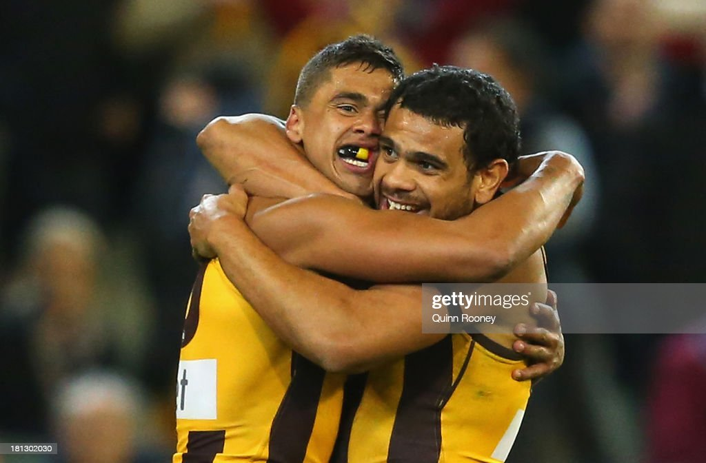 Bradley Hill and Cyril Rioli of the Hawks celebrates winning the AFL First Preliminary Final match between the Hawthorn Hawks and the Geelong Cats at Melbourne Cricket Ground on September 20, 2013 in Melbourne, Australia.