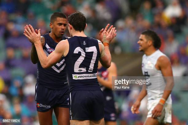 Bradley Hill and Lachie Neale of the Dockers celebrate a goal during the round nine AFL match between the Fremantle Dockers and the Carlton Blues at...