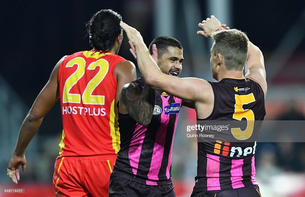 Bradley Hill and Sam Mitchell of the Hawks celebrate a goal during the round 14 AFL match between the Hawthorn Hawks and the Gold Coast Suns at Aurora Stadium on June 26, 2016 in Launceston, Australia.