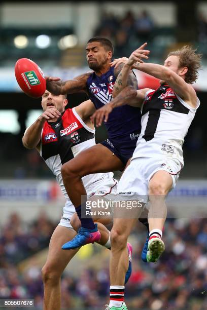 Bradley Hill of the Dockers contests a mark against Nathan Brown and Jimmy Webster of the Saints during the round 15 AFL match between the Fremantle...