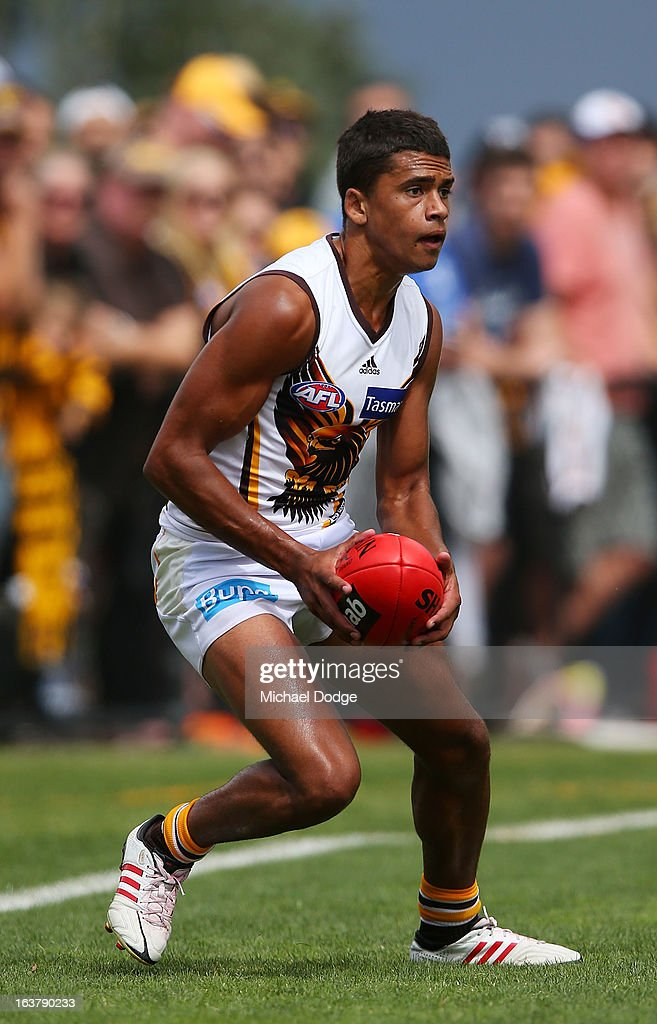 Bradley Hill of the Hawks looks ahead with the ball during the AFL NAB Cup match between the North Melbourne Kangaroos and the Hawthorn Hawks at Highgate Recreational Reserve on March 16, 2013 in Craigieburn, Australia.