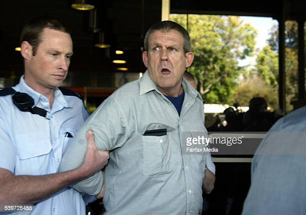 Bradley John Murdoch is led away by a policeman outside the Adelaide Supreme Court 10 November 2003 FOR FAIRFAX NEWS Picture by Bryan Charlton...