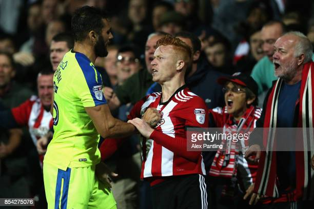 Bradley Johnson of Derby County and Ryan Woods of Brentford clash during the Sky Bet Championship match between Brentford and Derby County at Griffin...