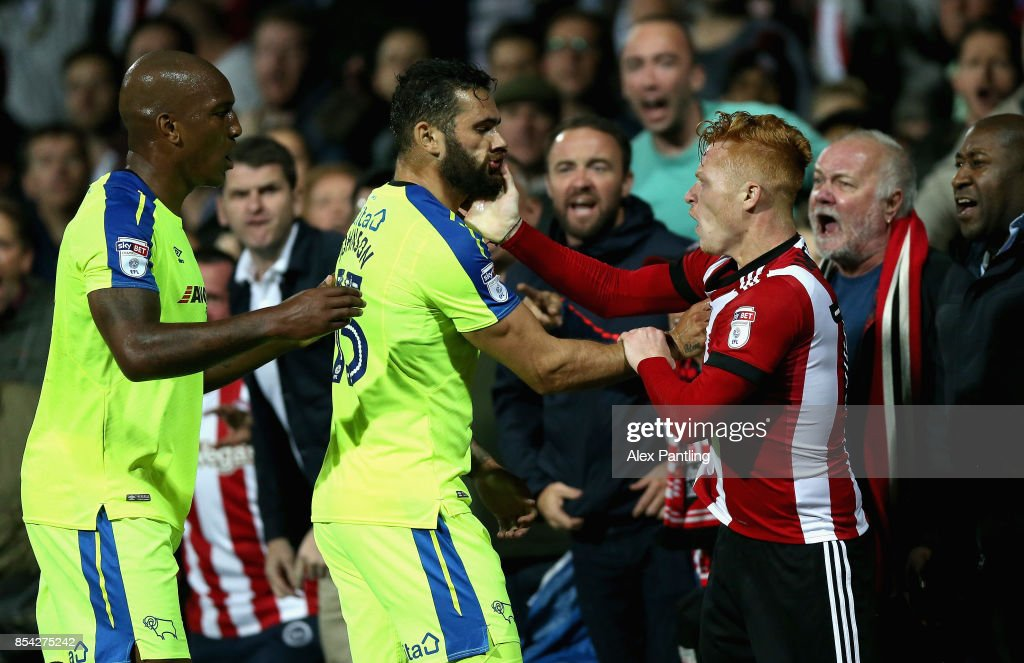 Bradley Johnson of Derby County and Ryan Woods of Brentford clash during the Sky Bet Championship match between Brentford and Derby County at Griffin Park on September 26, 2017 in Brentford, England.