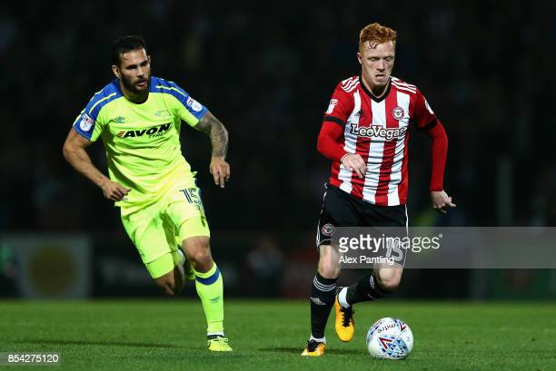 Bradley Johnson of Derby County chases down Ryan Woods of Brentford during the Sky Bet Championship match between Brentford and Derby County at...