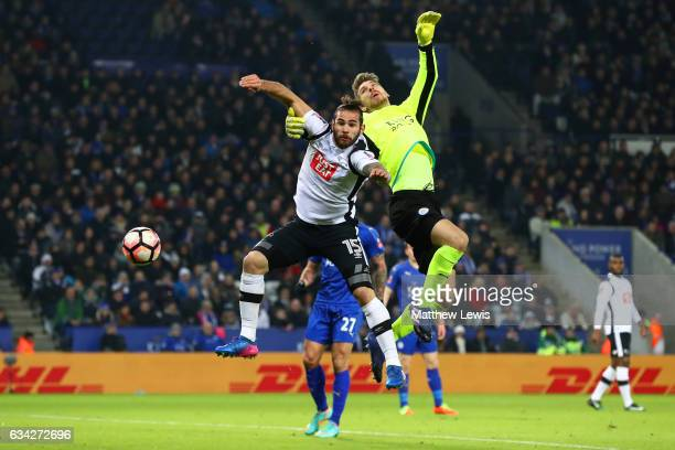 Bradley Johnson of Derby County jumps for the ball with RonRobert Zieler of Leicester City during the Emirates FA Cup Fourth Round replay match...