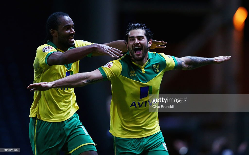 Bradley Johnson of Norwich City celebrates scoring the winning goal with team mate <a gi-track='captionPersonalityLinkClicked' href=/galleries/search?phrase=Cameron+Jerome&family=editorial&specificpeople=815275 ng-click='$event.stopPropagation()'>Cameron Jerome</a> during the Sky Bet Championship match between Blackburn Rovers and Norwich City at Ewood Park on February 24, 2015 in Blackburn, England.