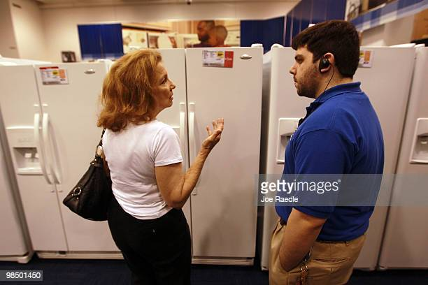 Bradley Lewter a customer experience specialist helps Carol Nagengast as she shops for an appliance at the Best Buy store on April 16 2010 in Miami...