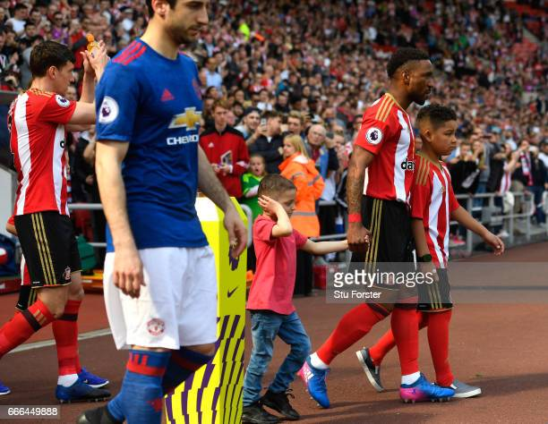 Bradley Lowery walks out with Jermain Defoe of Sunderland during the Premier League match between Sunderland and Manchester United at Stadium of...