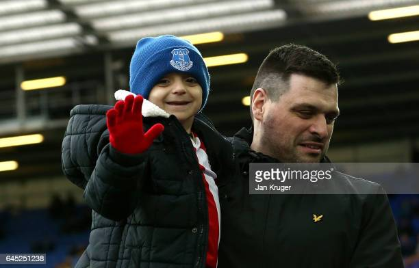 Bradley Lowery with his Dad Carl waves prior to the Premier League match between Everton and Sunderland at Goodison Park on February 25 2017 in...