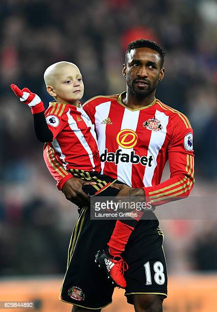 Bradley Lowrey and Jermain Defoe of Sunderland walk into the pitch prior to the Premier League match between Sunderland and Chelsea at Stadium of...