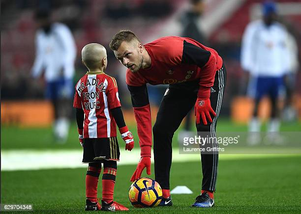 Bradley Lowrey speaks to Sebastian Larsson of Sunderland during the warm up prior to kick off during the Premier League match between Sunderland and...