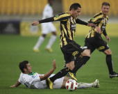 Bradley McDonald of the Fury is tackled by Leo Bertos of the Phoenix during the round eight ALeague match between the Wellington Phoenix and the...
