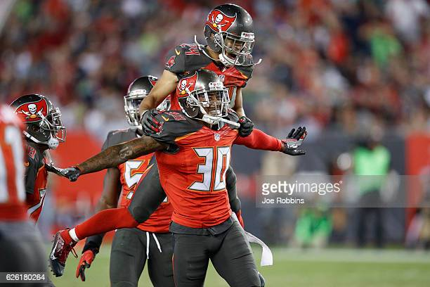 Bradley McDougald and Brent Grimes of the Tampa Bay Buccaneers celebrate after a fourth down stop against Seattle Seahawks in the fourth quarter of...