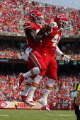 Bradley McDougald and Cyrus Gray of the Kansas City Chiefs celebrate after successfully downing the punt within the Dallas Cowboys five yard line in...