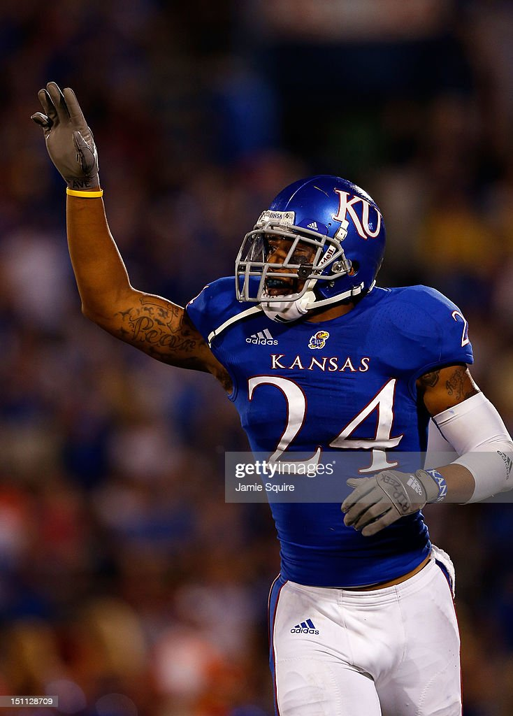 Bradley McDougald #24 of the Kansas Jayhawks celebrates after making an interception during the game against the South Dakota State Jackrabbits at Memorial Stadium on September 1, 2012 in Lawrence, Kansas.