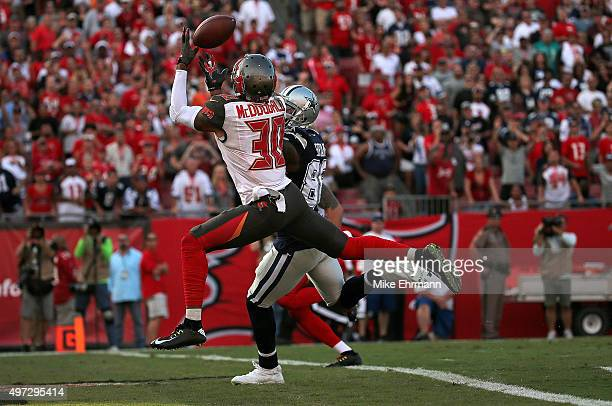 Bradley McDougald of the Tampa Bay Buccaneers catches a game winning interception over Dez Bryant of the Dallas Cowboys during a game at Raymond...