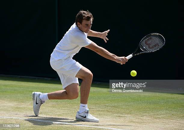 Bradley Mousley of Australia plays a backhand during the Boys' Doubles second round match against Benjamin Bonzi of France and Quentin Halys of...