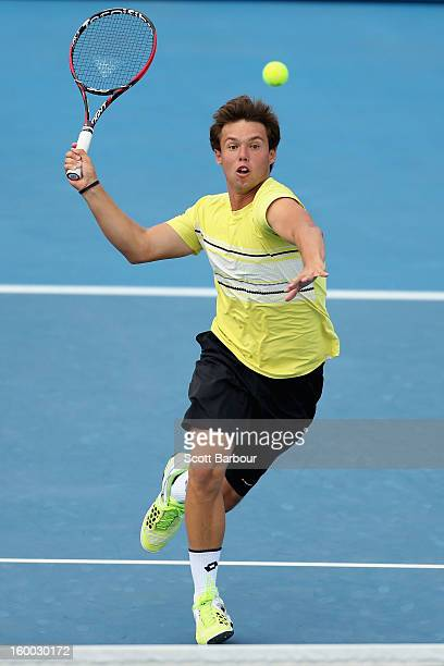 Bradley Mousley of Australia plays a forehand in his Junior Boys' Doubles Final match with Jay Andrijic of Australia against Maximilian Marterer of...