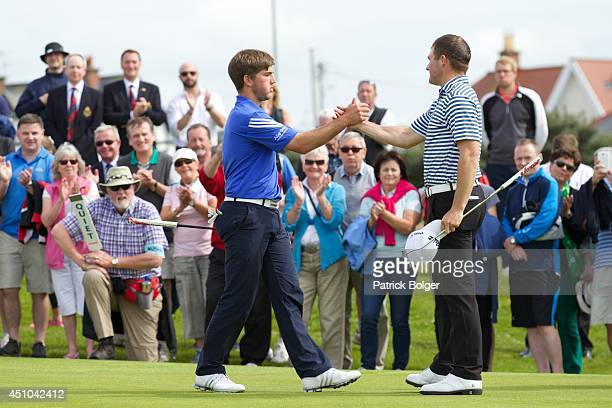 IRELAND JUNE 22 Bradley Neil in blue is congratulated by Zander Lombard after his 2 1 victory in the final of The Amateur Championship at Royal...