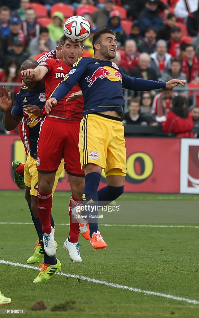 TORONTO, ON- MAY 17 - Bradley Orr gets his head on a corner kick as he battles Armando as Toronto FC beats the New York Red Bulls 2-0 at BMO Field in Toronto. May 17, 2014.