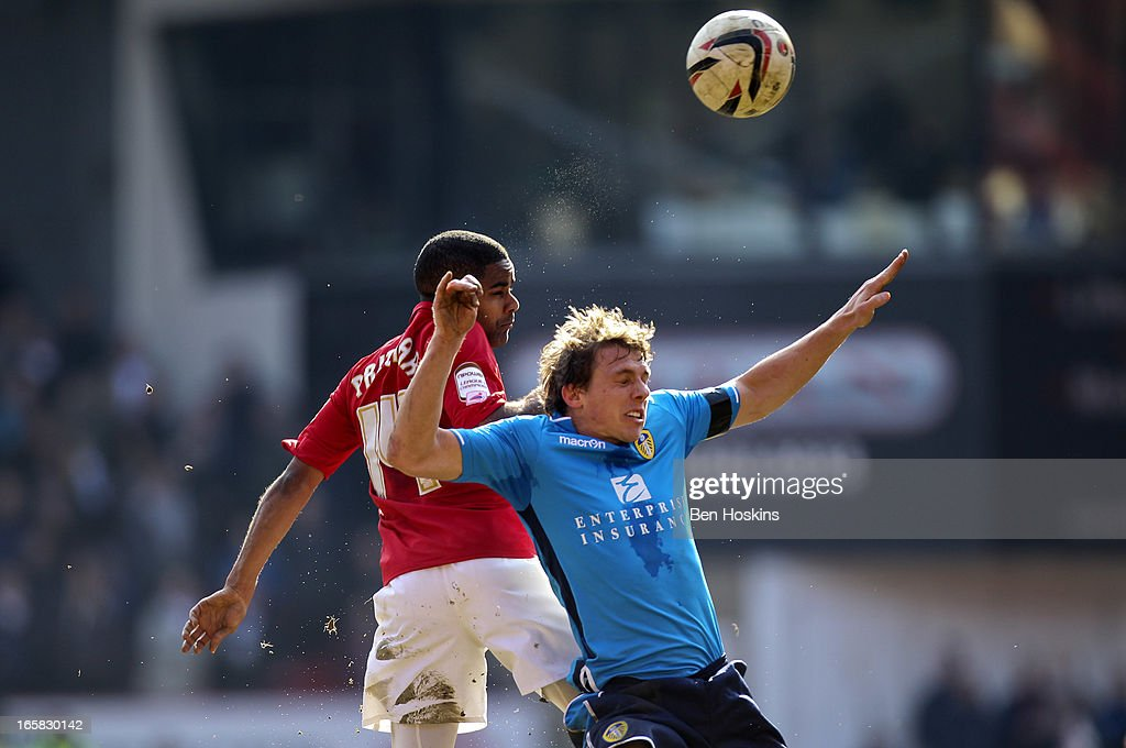 Bradley Pritchard of Charlton and Stephen Warnock of Leeds battle for an aerial ball during the npower Championship match between Charlton Athletic and Leeds United at the Valley on April 06, 2013 in London, England.