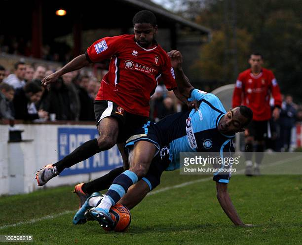 Bradley Pritchard of Hayes Yeading battles with Kevin Betsy of Wycombe during the Hayes and Yeading United FC and Wycombe Wanderers FA Cup 1st Round...