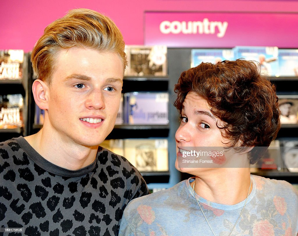 Bradley Simpson and Tristan Evans of The Vamps sign copies of their new single 'Can We Dance' at HMV Birmingham Bullring on October 4, 2013 in Birmingham, England.