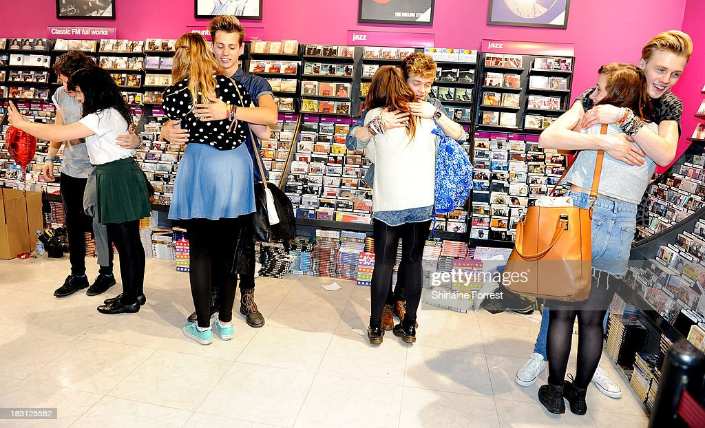 Bradley Simpson, James McVey, Connor Ball and Tristan Evans of The Vamps sign copies of their new single 'Can We Dance' at HMV Birmingham Bullring on October 4, 2013 in Birmingham, England.