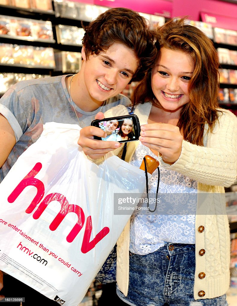 Bradley Simpson of The Vamps poses for selfies and signs copies of their new single 'Can We Dance' at HMV Birmingham Bullring on October 4, 2013 in Birmingham, England.