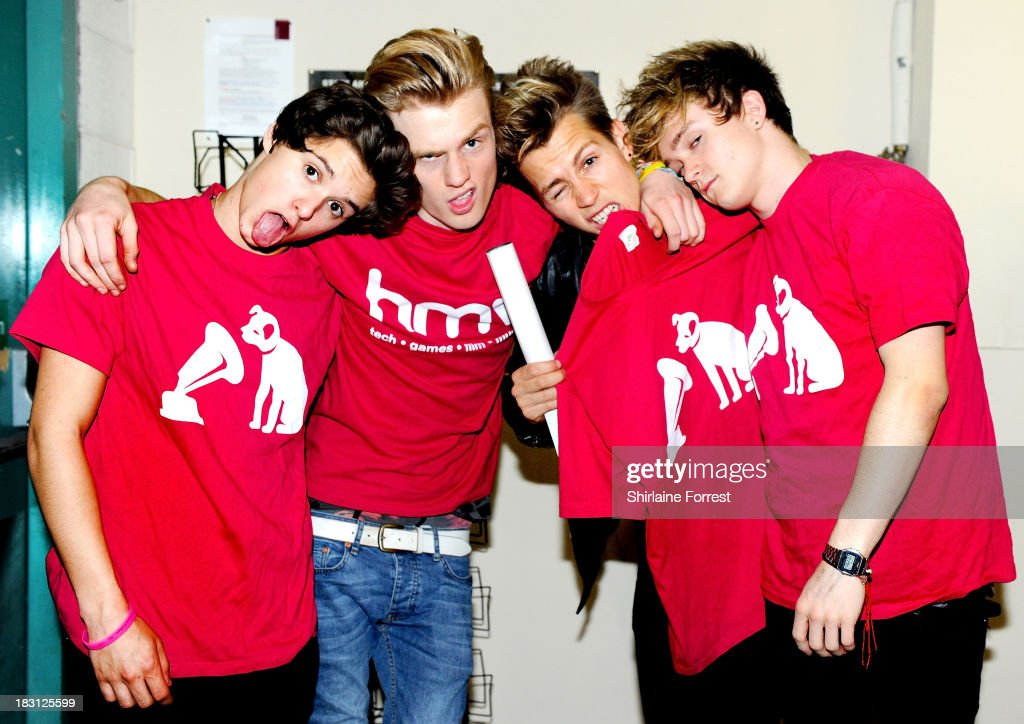 Bradley Simpson, Tristan Evans, James McVey and Connor Ball of The Vamps pose backstage after signing copies of their new single 'Can We Dance' at HMV Birmingham Bullring on October 4, 2013 in Birmingham, England.