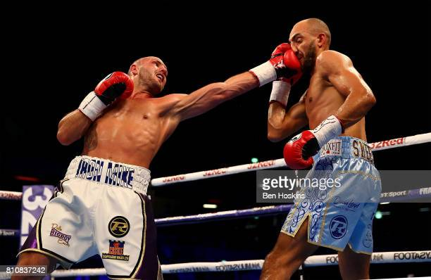 Bradley Skeete of Great Britain and Dale Evans of Great Britain exchange blows during their British Welterweight Championship bout at Copper Box...