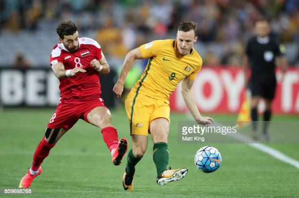 Bradley Smith of Australia is challenged by Mahmoud Al Mawas of Syria during the 2018 FIFA World Cup Asian Playoff match between the Australian...