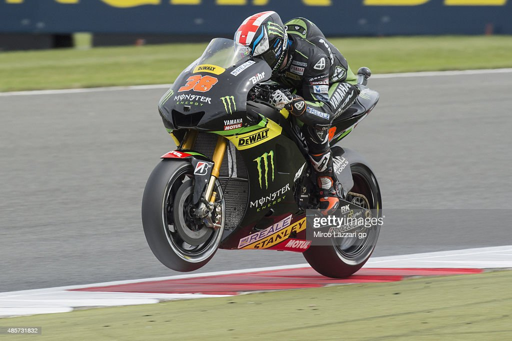 <a gi-track='captionPersonalityLinkClicked' href=/galleries/search?phrase=Bradley+Smith+-+Motorcyclist&family=editorial&specificpeople=5349000 ng-click='$event.stopPropagation()'>Bradley Smith</a> of Great Britain and Monster Yamaha Tech 3 lifts the front wheel during the qualifying practice during MotoGp Of Great Britain - Qualifying at Silverstone Circuit on August 29, 2015 in Northampton, United Kingdom.
